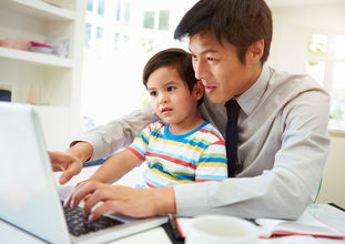 Business man with child at computer