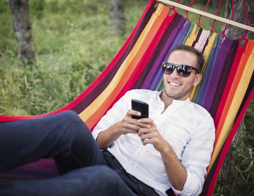 Man_hammock_cellphone
