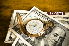 Gold watch and currency